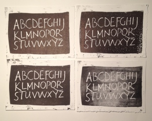 Freely written alphabet cut in wood and printed letterpress